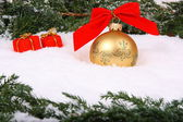 Bauble with gift box — Stock Photo