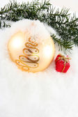 Christmas bauble with gift box — Stock Photo