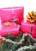 Gifts with pine branch — Stock Photo