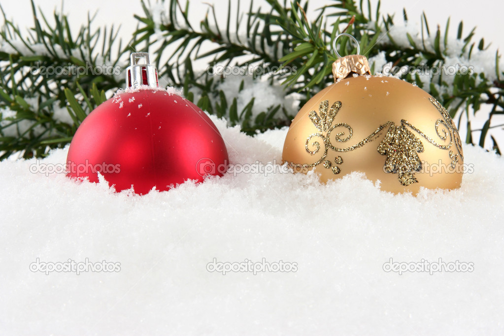 Red and golden christmas ball on white snow  Stock Photo #3907717