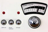 Toaster dial and chrome knobs — Stock Photo