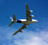 Passenger aircraft banking in sky — Stock Photo