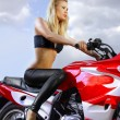 Pretty blonde on a motorcycle - Stock Photo
