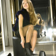 Girl fits on a boots in a boutique — Stock Photo
