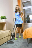 Housewife with vacuum cleaner — Stock Photo