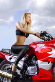 Pretty blonde on a motorcycle — Stock Photo