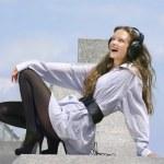 Happy girl is listening music — Stock Photo