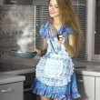 Happy housewife in modern kitchen - Stock Photo