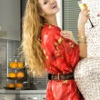 Happy blonde woman in the modern kitchen - Stock Photo