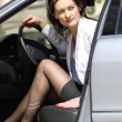 Постер, плакат: Woman parks the car