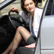 Woman parks the car - Stock Photo