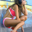 Stock Photo: Girl in bathing suit is listening music