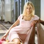 Sexy blonde near shopping mall — Stock Photo