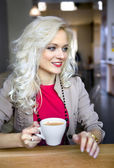 Blonde in cafeteria — Stock Photo