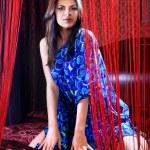 Woman in dark blue dress — Stock Photo