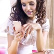 Woman with smartphone - Stock Photo