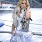 Sad blonde with fox — Stock Photo