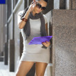 Businesswoman near a business building - Stock Photo