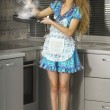 Housewife in the kitchen — Stock Photo