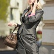 Preoccupied city woman - Stock Photo