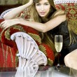 Rich woman near a coffee table — Stockfoto