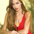 Pretty girl with glass of champagne — Stock Photo