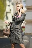 Preoccupied city woman — Stock Photo