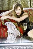 Rich woman near a coffee table — Stock Photo