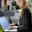 Happy businesswoman with laptop computer — Stock Photo