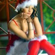 Pretty girl wearing santa claus clothes — Stock Photo