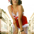 Woman wearing santa claus red clothes — 图库照片