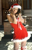 Sweet woman wearing santa claus clothes — Stock Photo