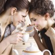 Happy girl-friends with cups — Stock Photo
