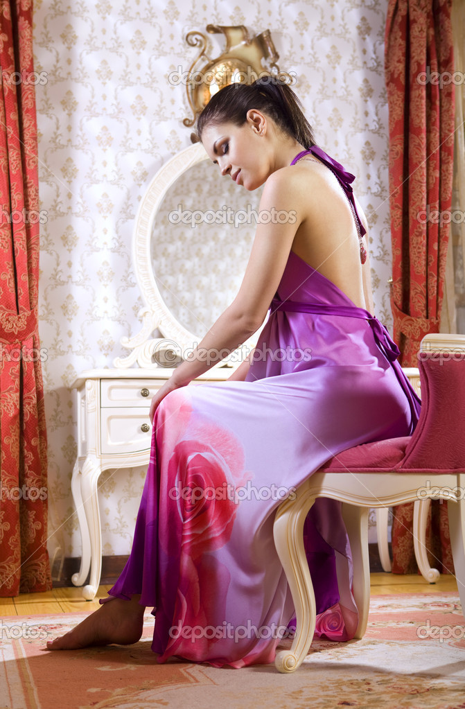 Woman wearing pink night dress in her room of luxury hotel — Stock Photo #3010239