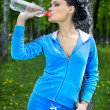 Girl drinks water — Stock Photo