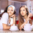 Happy women on kitchen — Stock Photo