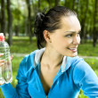 Happy woman with bottle — Stock Photo