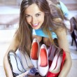 Shopaholic with shoes — Stock Photo