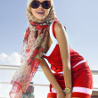 Foto Stock: Fashionable girl in red dress