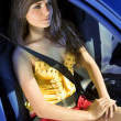 Stock Photo: Girl in car fastened by seat belt