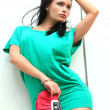 Girl in green short dress - Foto Stock