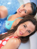 Young girls in jacuzzi — Stock Photo