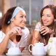 Stock Photo: Happy women with wine in kitchen