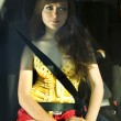 Stock Photo: Womfastened by seat belt