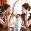 Two pretty girl-friends drink tea — Stock Photo