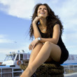 Happy girl on landing stage - ストック写真