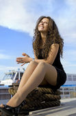 Cheerful girl on landing stage — Stock Photo