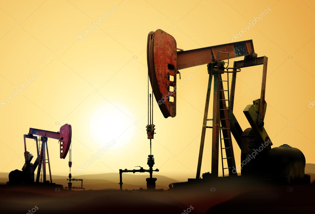 Working oil pump in deserted district at sunset — Stock Photo #3283793