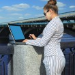 Woman with laptop on quay — Stock Photo