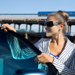 Stock Photo: Woman in sunglasses near the car